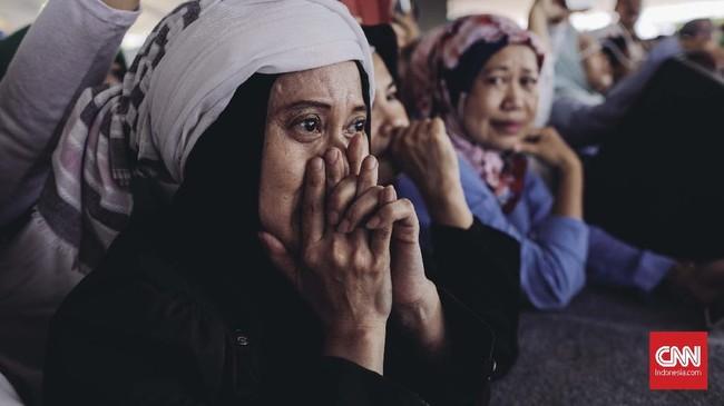 Dalam acara ini, Prabowo menyempatkan diri minum susu bersama delapan orang wanita hamil.(CNN Indonesia/Adhi Wicaksono)