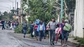 Setelah badai reda, para pengungsi kembali ke rumah mereka masing-masing(Photo by ALFREDO ESTRELLA / AFP)