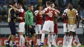 Arsenal merayakan kemenangan atas Sporting Lisbon di Estadio Jose Alvalade. Arsenal kini unggul tiga poin atas Sporting di klasemen Grup E. (REUTERS/Rafael Marchante)