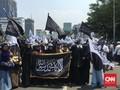 Massa Bawa Spanduk 'Bubarkan Banser' di Aksi Bela Tauhid