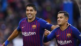 Philippe Coutinhyo membuka keunggulan Barcelona di menit ke-11. Coutinho memaksimalkan umpan silang yang dilepaskan oleh Jordi Alba. (Photo by GABRIEL BOUYS / AFP)