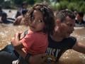FOTO: Imigran Honduras Pertaruhkan Nyawa Demi Paman Sam