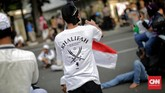 Setelah bertemu Menkopolhukam Wiranto, massa membubarkan aksi dengan tertib. (CNN Indonesia/Adhi Wicaksono)