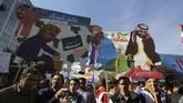 Ribuan warga Iran berunjuk rasa memperingati Revolusi Islam 1979 di Ibu Kota Teheran, dan pemberian kembali sanksi AS. (AFP Photo/Atta Kenare)