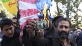 Warga Iran kecewa karena AS tidak menepati janji padahal di masa lalu sudah bersepakat membatasi produksi uranium. (AFP Photo/Atta Kenare)
