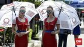 Gadis payung tim Pramac Racing. Duo pebalap tim tersebut, Jack Miller dan Danilo Petrucci finis berurutan di posisi ke-8 dan 9. (CNN Indonesia/Haryanto Tri Wibowo)
