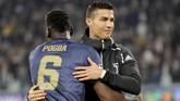 Juventus masih memimpin klasemen dengan nilai sembilan poin, beda dua angka dari Manchester United yang ada di posisi kedua. (REUTERS/Massimo Pinca)