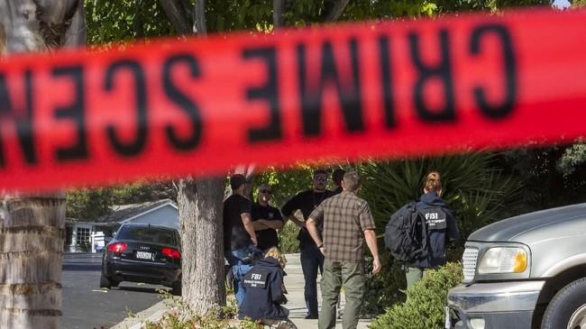 Sebuah bar di California berubah bak neraka ketika seorang veteran Marinir Amerika Serikat tiba-tiba masuk dan melepaskan tembakan membabi buta hingga menewaskan 12 orang pada Rabu (7/11). (AFP Photo/Apu Gomes)