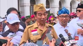 VIDEO: Hari Pahlawan, Jokowi Berseragam Militer Gowes Ontel