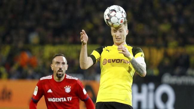 Bintang-bintang sepak bola yang menjadi tulang punggung kedua tim saling beradu seperti Marco Reus dan Franck Ribery yang bertemu di lini tengah. (REUTERS/Kai Pfaffenbach)