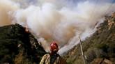 Menurut kepolisian, sejak kebakaran meluas pada Kamis pekan lalu, masih ada 228 orang yang belum diketahui keberadaannya. (Reuters/Eric Thayer)