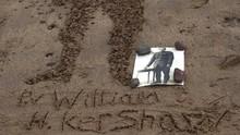 FOTO: Mengenang Pedih Perang Dunia I Lewat Lukisan di Pasir