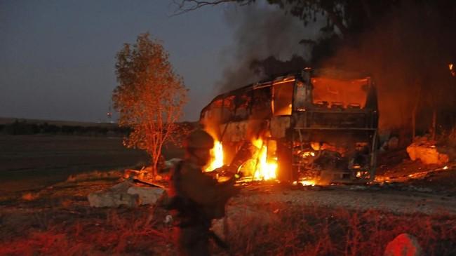 Perserikatan Bangsa-Bangsa meminta Israel dan Hamas menyudahi pertempuran dan menahan diri. Sebab hal ini bisa merusak perundingan damai tengah dirintis. (Photo by Menahem KAHANA / AFP)
