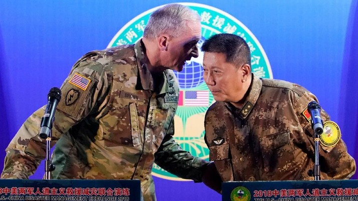General Robert Brown, commanding general of the U.S. Army Pacific and China's People's Liberation Army (PLA) Lieutenant General Qin Weijiang attend a news conference of an exercise of