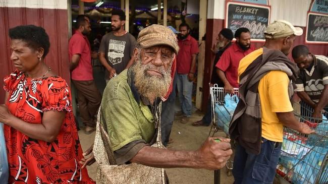 Tingkat pengangguran di Papua Nugini cukup tinggi dan berdampak langsung terhadap kehidupan sosial mereka. (Photo by PETER PARKS / AFP)
