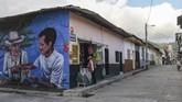 Kini San Carlos ingin dipandang berbeda, terbuka untuk turisme yang mampu menawarkan banyak wisata, dengan fasilitas akomodasi baik, termasuk 56 mural ini. (Photo by JOAQUIN SARMIENTO / AFP)