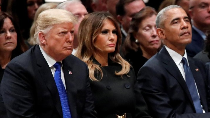 President Donald Trump, first lady Melania Trump and former President Barack Obama listen as former Canadian Prime Minister Brian Mulroney speaks during a State Funeral at the National Cathedral, Wednesday, Dec. 5, 2018, in Washington, for former President George H.W. Bush. Alex Brandon/Pool via REUTERS