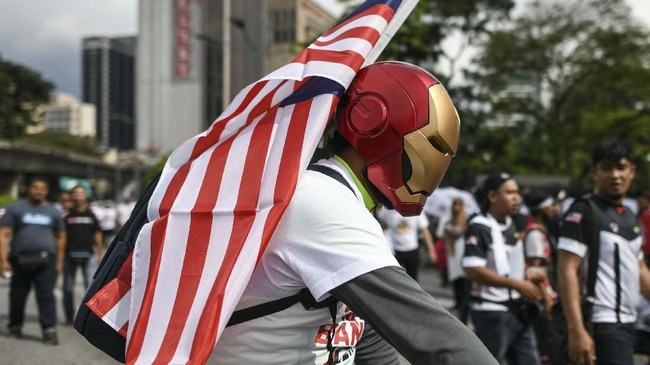 Demonstran beralasan ratifikasi ICERD akan mengganggu stabilitas negara yang selama ini dikuasai oleh etnis Melayu, dan enggan memberi ruang kepada keturunan China dan India. (Photo by Mohd RASFAN / AFP)