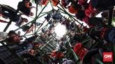 Fanatisme pendukung Persija Jakarta menular ke sudut-sudut kota Jakarta. (CNN Indonesia/Hesti Rika)