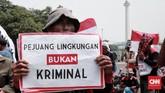 Aksi ini merupakan bagian peringatan Hari Hak Asasi Manusia Internasional saban 10 Desember. Dalam aksinya, massa menuntut pemerintah menghentikan kriminalisasi pejuang lingkungan hidup sebagai bentuk implementasi Pasal 66 UU Nomor 32/2009 tentang Perlindungan dan Pengelolaan Lingkungan Hidup. (CNNIndonesia/Andry Novelino).