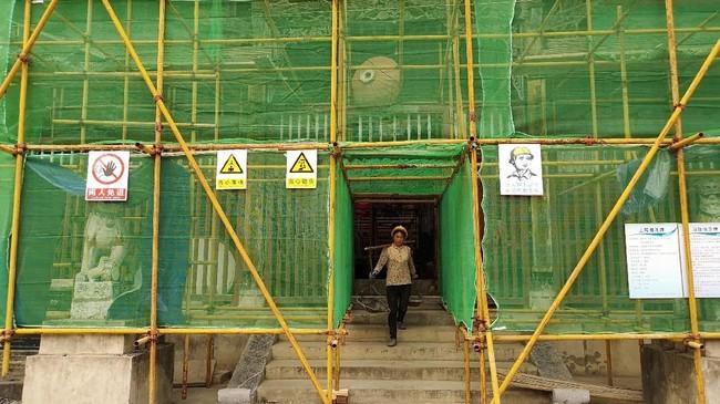 Pejabat daerah setempat memutuskan menghemat pengeluaran dengan memangkas investasi publik dalam proyek infrastruktur. Di sisi lain, penjualan lahan pemerintah setempat digencarkan demi menggemukkan pendapatan daerah. (REUTERS/Shu Zhang).
