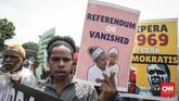 Operasi Trikora yang diperingati massa aktivis Papua itu adalah operasi militer pada era kepresidenan Soekarno selama hampir dua tahun untuk menggabungkan Papua bagian barat dengan wilayah Indonesia. (CNNIndonesia/Safir Makki)