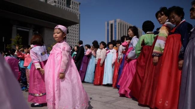 Kini, hampir tiga perempat wanita Korsel berusia 20-40 tahun memandang pernikahan sebagai sesuatu yang tak perlu. (Photo by Ed JONES/AFP)