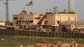 Presiden Donald Trump menyatakan keputusan menarik pasukan dari Suriah karena mengklaim telah berhasil menaklukkan ISIS. (Photo by Delil SOULEIMAN / AFP).