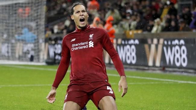 Virgil van Dijk merayakan gol ke gawang Wolverhampton. Ini adalah kali pertama bek asal Belanda itu di Liga Primer Inggris musim ini. (Reuters/Carl Recine)