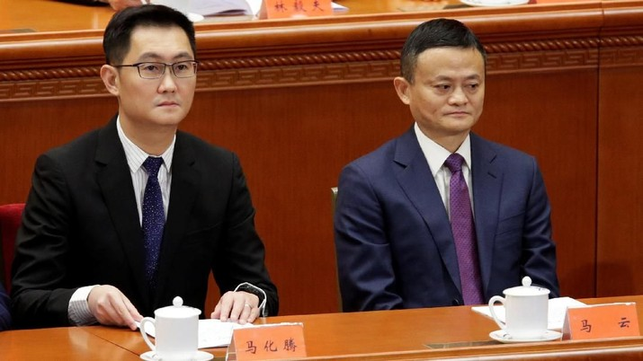 Tencent's Chief Executive Officer Pony Ma and Alibaba's Executive Chairman Jack Ma attend an event marking the 40th anniversary of China's reform and opening up at the Great Hall of the People in Beijing, China December 18, 2018.  REUTERS/Jason Lee