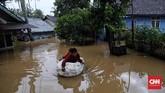 Kampung Kadugareng atau Sukarame atau Karanganyar Rt 04/03, Pandeglang terendam air luapan sungai Cipunten Agung yang langsung mengalir ke laut. (CNN Indonesia/Hesti Rika).
