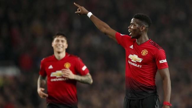 Paul Pogba merayakan gol kedua ke gawang Huddersfield Town. Pogba kembali bersinar bersama Manchester United setelah Jose Mourinho digantikan Ole Gunnar Solskjaer. (REUTERS/David Klein)