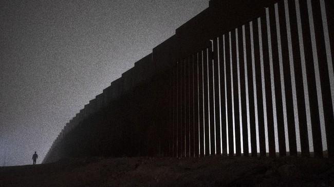 Presiden AS, Donald Trump menyatakan berkeras mempertahankan penutupan pemerintahan, selama anggaran proyek tembok perbatasan AS-Meksiko tak disetujui. (Photo by Guillermo Arias / AFP)