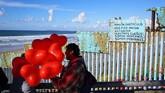 Tembok pemisah antara AS dan Meksiko menjadi program utama Presiden Trump, dengan alasan menangkal pendatang gelap. (Sandy Huffaker/Getty Images/AFP)