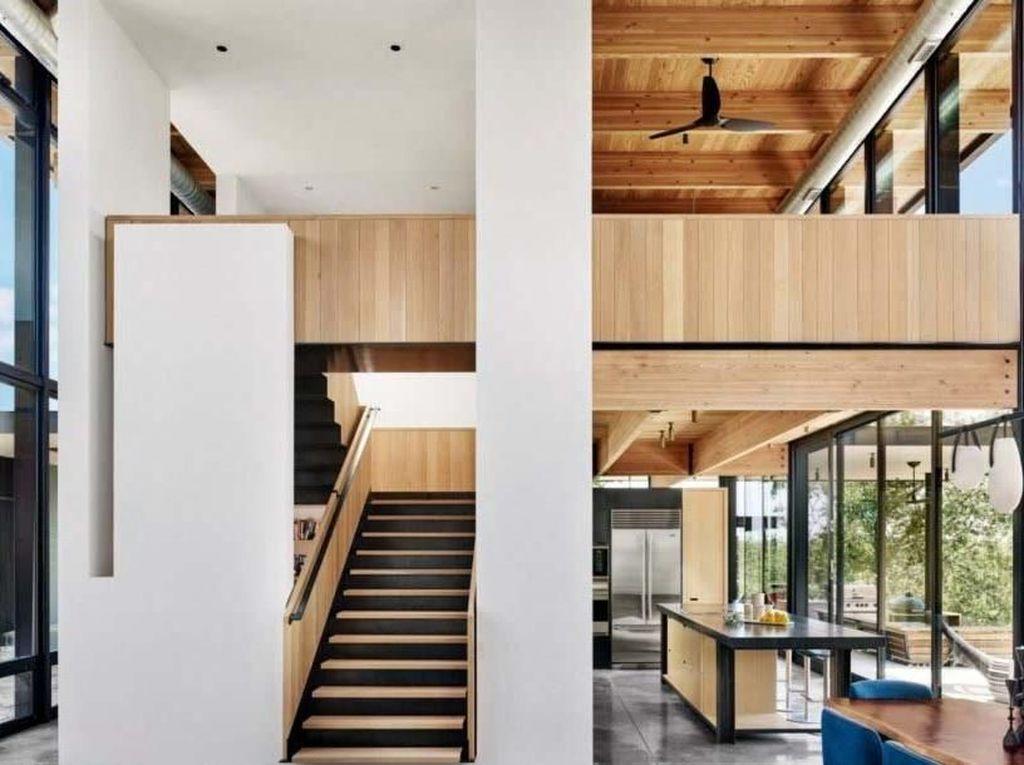 Rumah ini memiliki desain estetik dengan lebih banyak ruang terbuka agar udara bisa lebih mudah keluar masuk. Casey Dunn/Inhabitat.com.