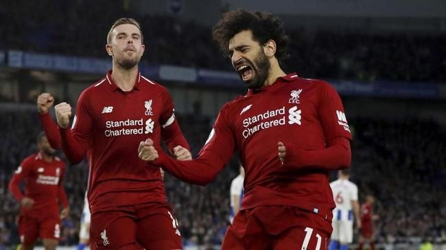 Mohamed Salah melakukan selebrasi setelah mencetak gol ke gawang Brighton yang menjadi gol ke-14 bagi pemain Mesir itu di ajang Liga Inggris 2018/2019. (Action Images via Reuters/Paul Childs)