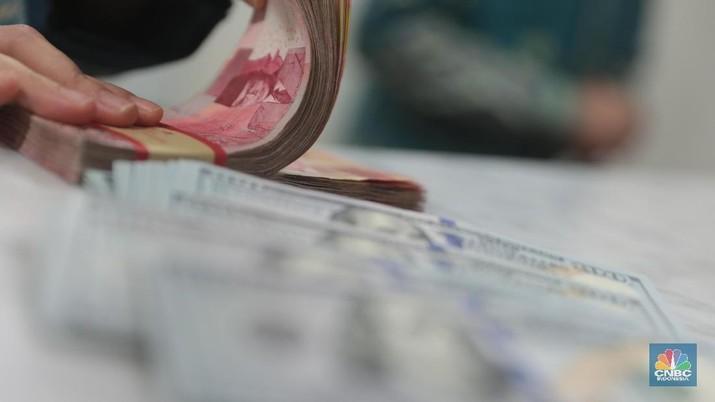 Pukul 12.00 WIB: Rupiah Pangkas Pelemahan ke Rp 13.700/US$