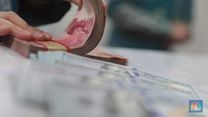 Pukul 12.00 WIB: Rupiah Tertahan di Rp 13.700/US$