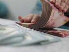 Pukul 14.00 WIB: Rupiah Pangkas Pelemahan ke Rp 15.600/US$