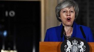 Kicau Rasis Trump Pancing Amarah Theresa May