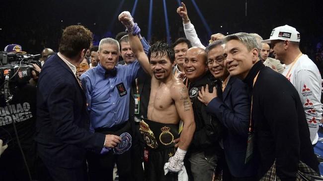 FOTO: Pacquiao Kalahkan Broner Lewat Kemenangan Angka Mutlak