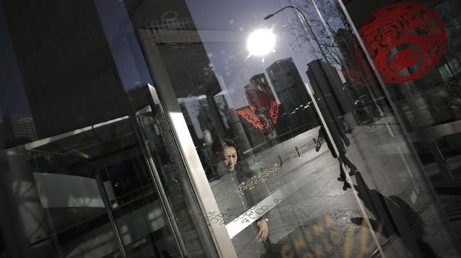 Tanda-tanda perlambatan ekonomi China sebenarnya telah tampak sejak beberapa bulan lalu. (AP Photo/Andy Wong).