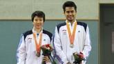 Tontowi Ahmad/Liliyana Natsir menelan kekecewaan karena hanya meraih medali perak di Asian Games 2014. Mereka kalah dari Zhang Nan/Zhao Yunlei di babak final.(Dok. Humas PBSI)