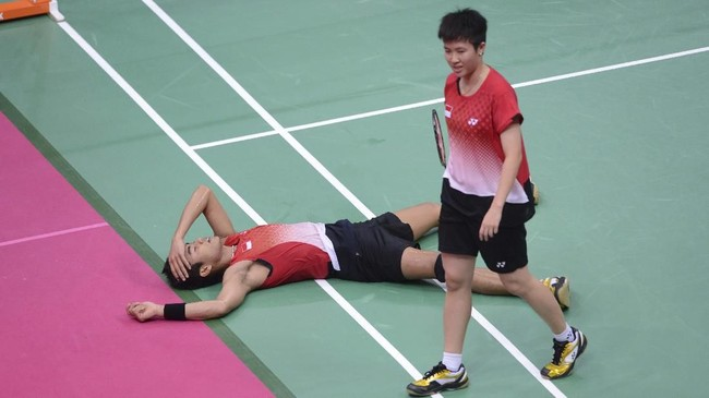 Tontowi Ahmad/Liliyana Natsir harus menelan kekecewaan di Olimpiade 2012. Tontowi/Liliyana kalah dari Xu Chen/Ma Jin dan kembali tumbang di perebutan medali perunggu. (AFP PHOTO / ADEK BERRY)
