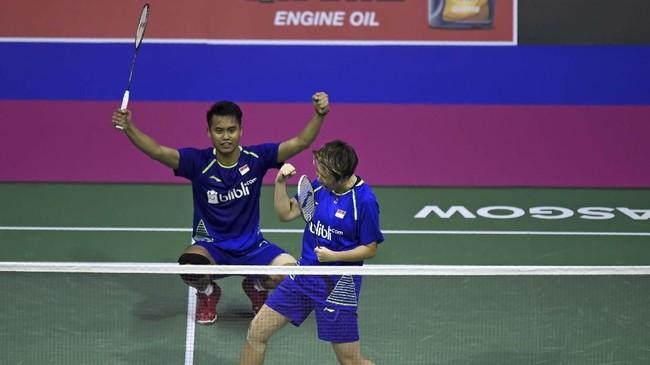 Tontowi Ahmad/Liliyana Natsir terus berpasangan usai sukses di Olimpiade. Mereka berhasil jadi juara dunia 2017, gelar juara dunia keempat untuk Liliyana Natsir. (Photo by ANDY BUCHANAN / AFP)