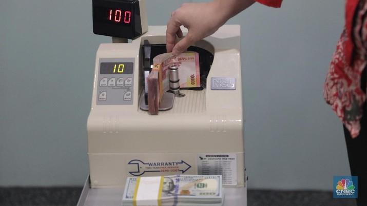 Pukul 11:00 WIB: Rupiah Masih Melemah di Rp 14.080/US$