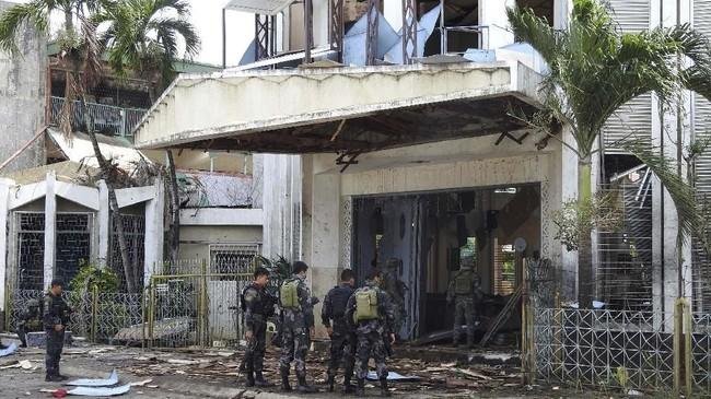 Undang-undang tersebut merupakan hasil dari kesepakatan damai antara pemerintah dan salah satu kelompok pemberontak Islam terbesar, Front Pembebasan Islam Moro (MILF). (AFP Photo/Nickee Butlangan)
