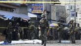 Filipina bersumpah akan memburu dalang di balik serangan bom di salah satu gereja yang menewaskan 20 orang pada Minggu (27/1). (AFP Photo/Nickee Butlangan)