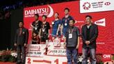 Tontowi Ahmad/Liliyana Natsir di atas podium Indonesia Masters 2019. Meski kalah di pertandingan terakhir kariernya, Liliyana mengaku bisa pensiun dengan tenang setelah meraih banyak sukses sepanjang kariernya. (CNN Indonesia/Andry Novelino)