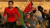Mohammad An-Najjar (12) terluka ketika dia mengikuti aksi unjuk rasa di Jalur Gaza, Palestina pada 11 Januari lalu. (REUTERS/Ibraheem Abu Mustafa)